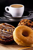 Sweets. Fresh doughnut and cookies with an espresso stock image