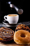 Sweets. Fresh doughnut and cookies with an espresso stock photography