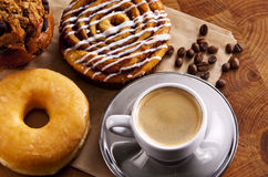Sweets. Fresh doughnut and cookies with an espresso royalty free stock image