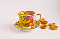 Sweets. Sweets with a multi-coloured cup of tea Royalty Free Stock Images