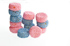 Sweets. A pile of blue & pink aniseed spogs, or sweets, isolated against a white background Royalty Free Stock Images