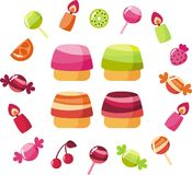 Sweets. Cakes with glaze, candles, fruits, berries and candy Stock Photo