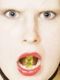 Sweets. Portrait of a beautiful woman with a bear in her mouth stock photography