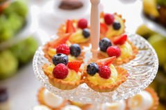 Sweets arrangements for wedding reception or similar events. Restaurant event food accessories decoration stock image