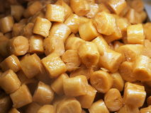 Sweets Background. A background of yellow colored sweets royalty free stock photography