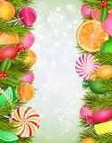 Sweets background with lollipop, candy, jelly beans, orange slice and pine tree Stock Photos
