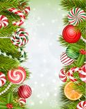 Sweets background with lollipop, candy, jelly beans, orange slice and pine tree Royalty Free Stock Photos