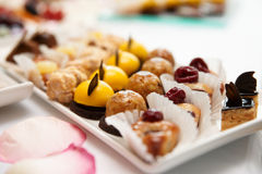 Sweets on banquet table Royalty Free Stock Images