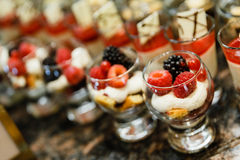 Sweets Canape (Cake Topping with Cream and Berries) in The Glass for International Lunch Buffet Line.  Stock Photography