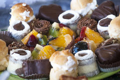 Sweets candies chocolates and fruits Stock Image