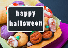 Sweets and candies for Halloween and blackboard Royalty Free Stock Images