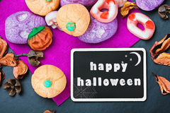 Sweets and candies for Halloween and blackboard Royalty Free Stock Photo