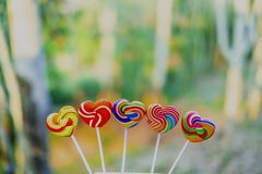 Sweets candies heart shape color full on blurred background, Set candy of color rainbow lollipops, Gift for Valentine day. Love concept royalty free stock images