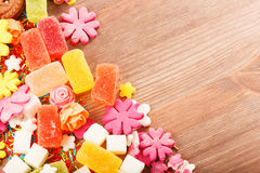 Sweets and candies on a wooden table Royalty Free Stock Photo