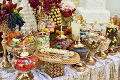 Sweets, candy, and nuts on table confectionery. Sweets, candy, and nuts on the table confectionery Stock Image