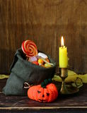 Sweets and candy traditional treat on Halloween. Bag with sweets and candy traditional treat on Halloween Royalty Free Stock Photography