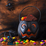 Sweets chocolate candy for Halloween in pumpkin, spider, web Royalty Free Stock Photos