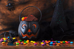Sweets chocolate candy for Halloween, witch hat, spider, web Stock Image