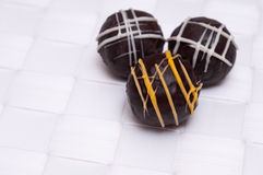Sweets with chocolates on white wallpaper Stock Photo