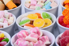 Sweets. Colorful sweets in cups. Studio shoot Stock Photos