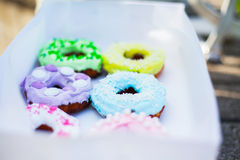 Sweets and colorful donuts in box Royalty Free Stock Images