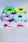 Sweets and colorful donuts in box Royalty Free Stock Image