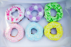 Sweets and colorful donuts in box Stock Photography