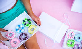 sweets and colorful donuts in box Stock Image