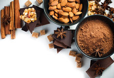Sweets concept isolated. Black and milk chocolate, cocoa powder, nuts, sweets, star anise, cinnamon and brown sugar on a white background, isolated, sweets Stock Photos