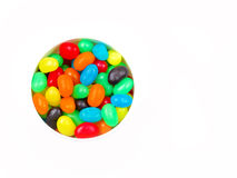 Sweets in a container on white Stock Image