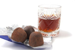 Sweets and a crystal wine-glass Royalty Free Stock Photos