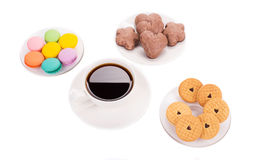 Sweets with cup of coffee Stock Images