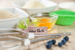 Sweets on diet: Ingredients for low carb cupcake cooking Royalty Free Stock Photos