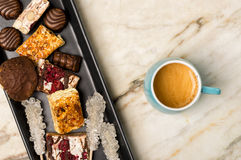 Sweets and espresso coffee. On a white marble surface Royalty Free Stock Image