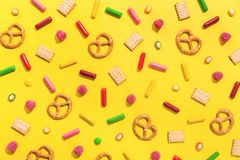 Sweets flat lay on yellow background royalty free stock photos