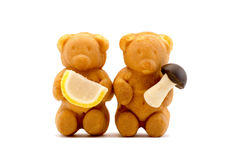 Sweets in the form of bears with condensed milk isolated Stock Image