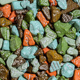 Sweets in the form of multi-colored stones, background Royalty Free Stock Photo