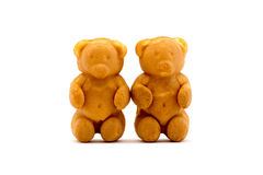 Sweets in the form of teddy bears with condensed milk isolated on a white Royalty Free Stock Images