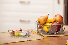 Sweets and fruits on the table Royalty Free Stock Photos