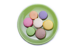Sweets on green plate Royalty Free Stock Image