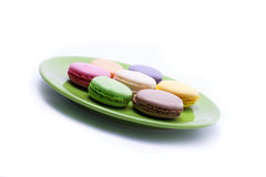 Sweets on green plate Stock Images