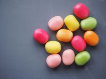 Sweets on grey background. Sweets grey background candy sugar unhealthy treat easter group diet bloodsugar diabetes obesity teeth dentist dietary colourful stock photography