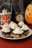 Sweets for Halloween. Muffins with chocolate haunted putty stock image