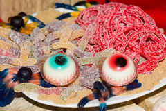 Sweets for Halloween on the holiday table. Stock Photos