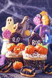Sweets for halloween party. On a wooden background royalty free stock photography