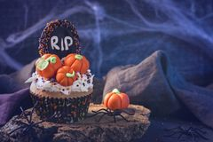 Sweets for halloween party. On a wooden background royalty free stock images
