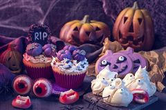 Sweets for halloween party. On a wooden background stock photography