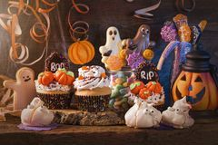 Sweets for halloween party. On a wooden background stock photo