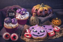 Sweets for halloween party. On a wooden background royalty free stock photo