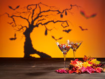 Sweets in Halloween setting with tree Royalty Free Stock Photos